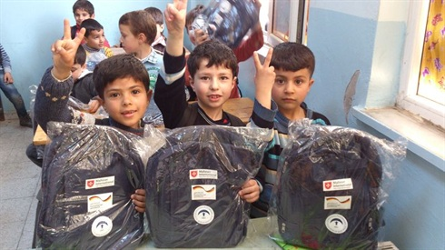 syrian refugee children aided at school in Turkey