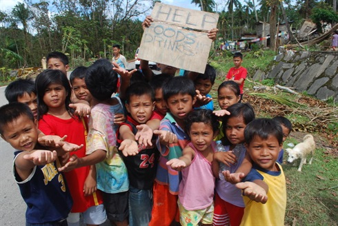 Bantayan Island, Philippines - young children beg for food
