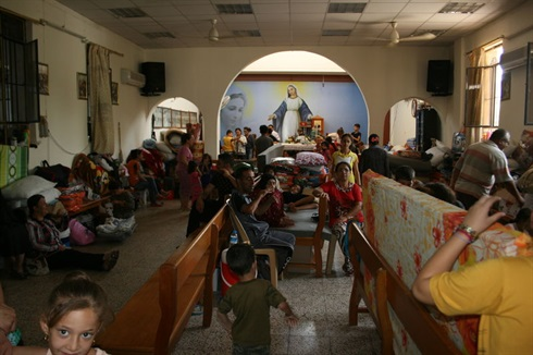 Iraq: refugees bed down in a church in Erbil