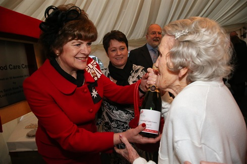 Wiltshire's Lord Lieutenant Mrs Sarah Troughton receives a gift from resident Mrs Margaret Mason