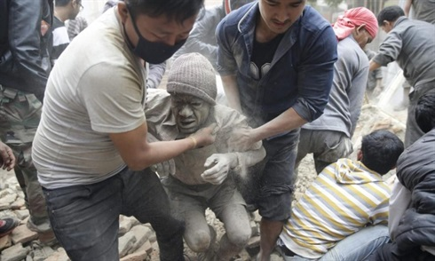 Nepal-rescue workers pull a survivor from the rubble