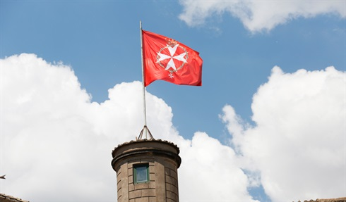 The flag of The Grand Master flies above The Magistral Villa, Aventino