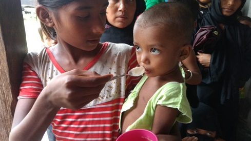 Bangladesh: a saline feed for a small patient, refugee camp mobile medical clinic