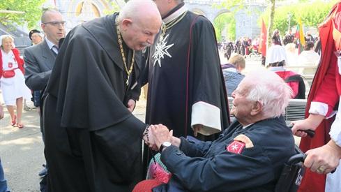 Fra'Giacomo greets a pilgrim