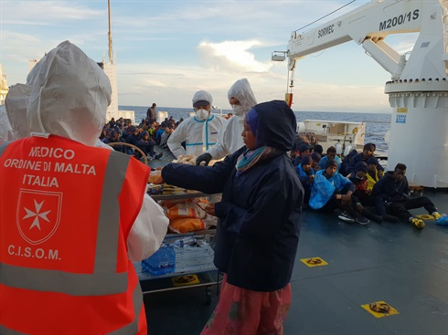 Valencia - Order of Malta volunteers give aid on board ship for migrants