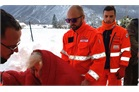 Italian Relief Corps team go to the assistance of elderly earthquake victim