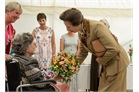 A resident presents the Princess Royal with a bouquet