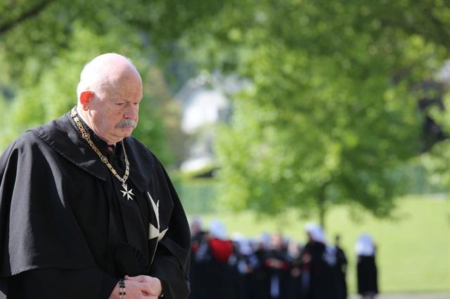 Fra Giacomo Dalla Torre prays at Lourdes