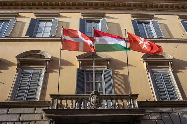 Hungarian flag flies beside that of the Sovereign Order